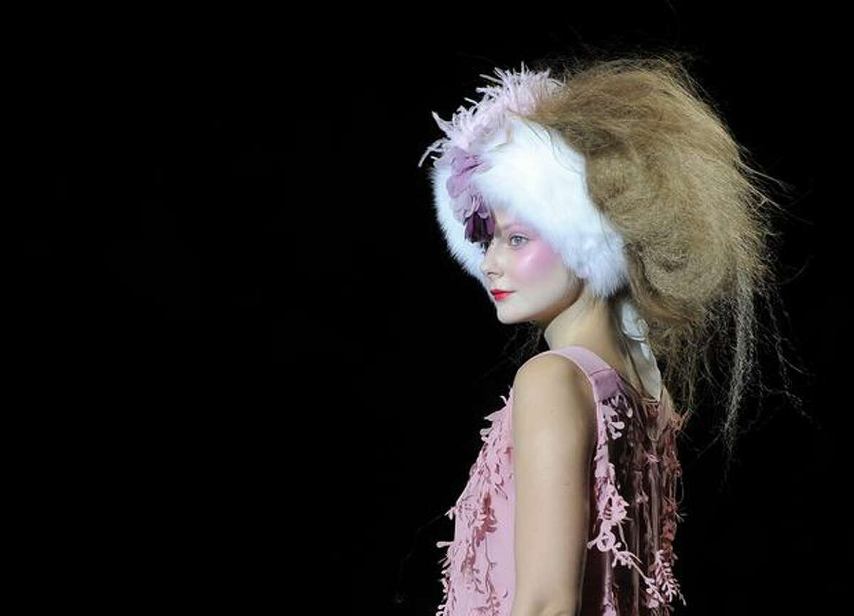 A model presents a creation by designer Elisa Palomino during the Madrid Cibeles Fashion week in Madrid.