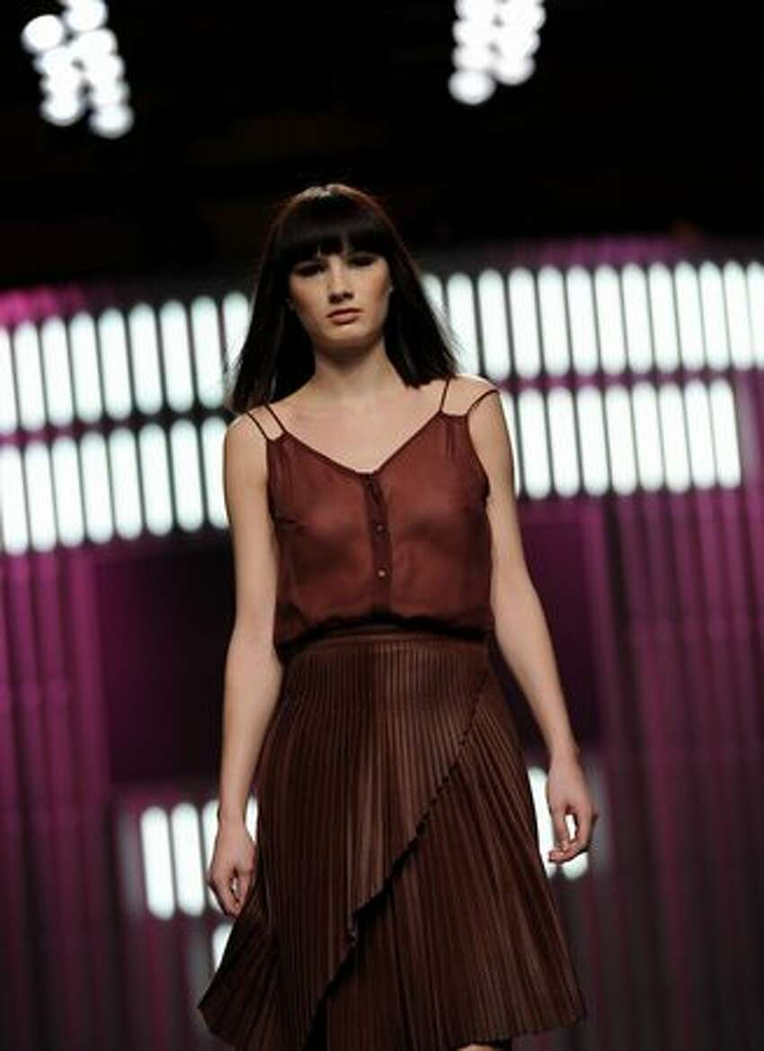 A model walks the runway in the El Colmillo de Morsa - Cati Serra fashion show during the Cibeles Madrid Fashion Week Autumn/Winter 2011 at the Ifema on February 23, 2011 in Madrid, Spain.