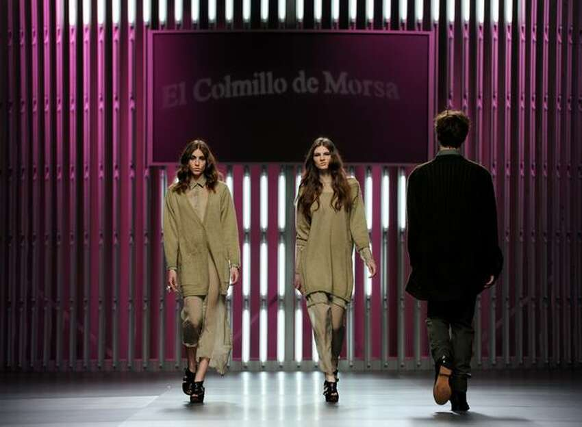 Models walk the runway in the El Colmillo de Morsa - Cati Serra fashion show during the Cibeles Madrid Fashion Week Autumn/Winter 2011 at the Ifema on February 23, 2011 in Madrid, Spain.