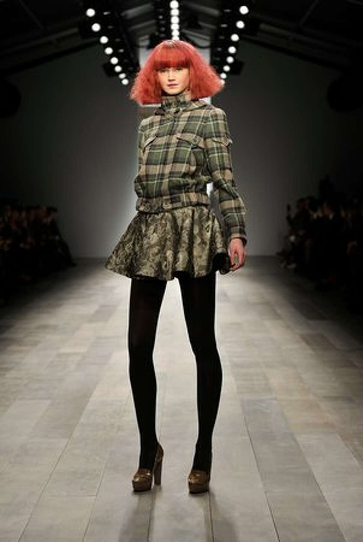 A model walks the runway at the Paul Costelloe show at the first day of London Fashion Week Autumn/Winter 2011 at Somerset House in London on Friday, Feb. 18, 2011.