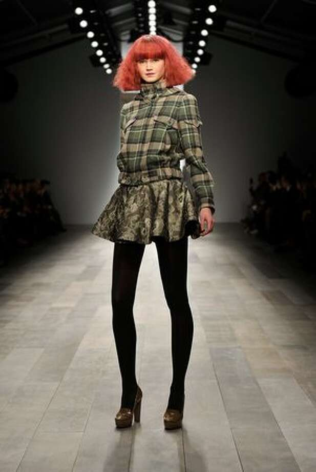 A model walks the runway at the Paul Costelloe show at the first day of London Fashion Week Autumn/Winter 2011 at Somerset House in London on Friday, Feb. 18, 2011. Photo: Getty Images / Getty Images