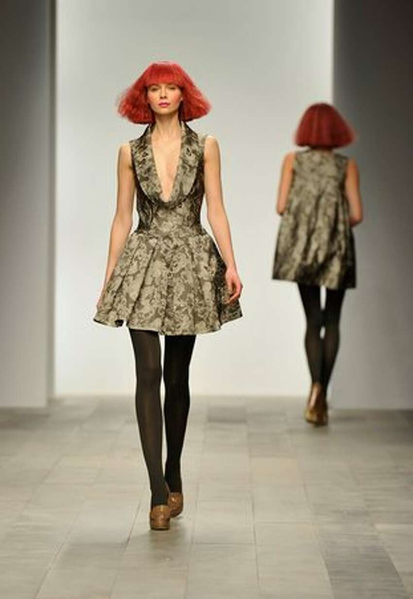 A model walks the runway at the Paul Costelloe show.