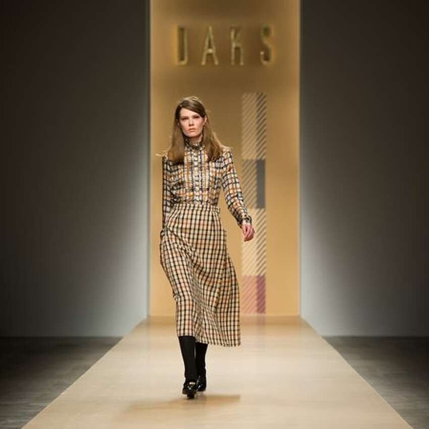 A model walks the runway at the DAKS show.