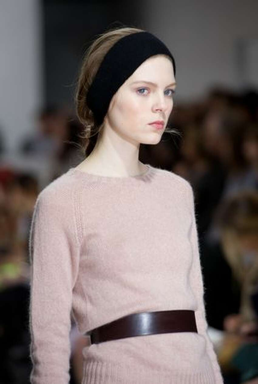A model walks the runway at the Margaret Howell show.