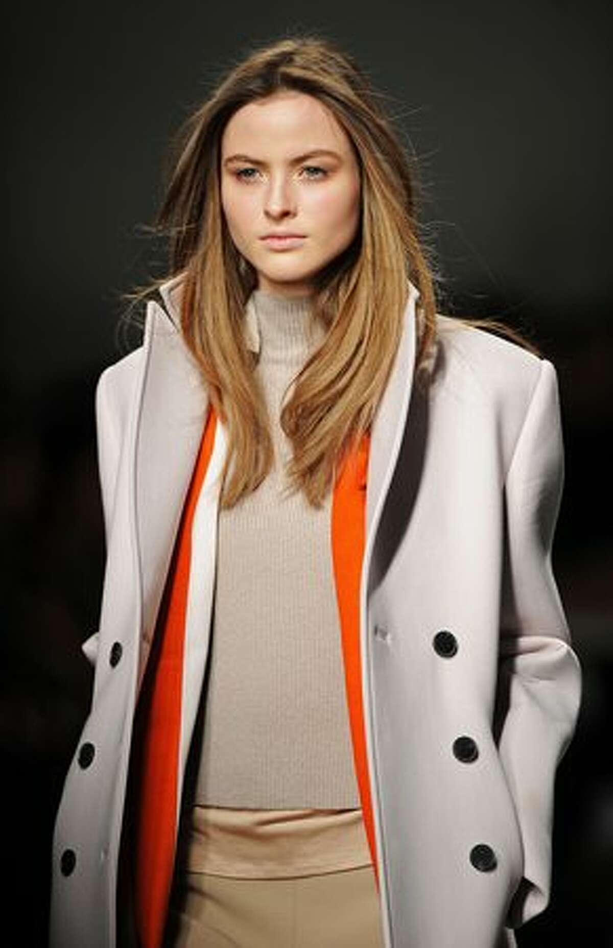 A model wears a creation during the Aquascutum Autumn/Winter 2011 collection show on the fifth day of London Fashion Week in London.