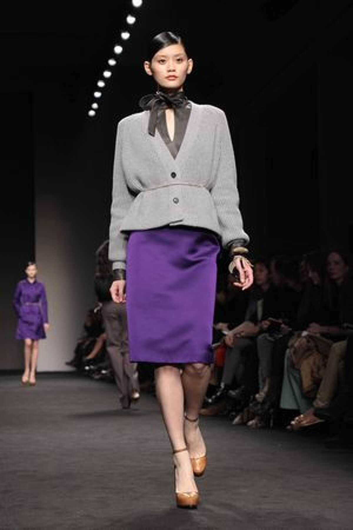 A model walks the runway during the Brioni fashion show.