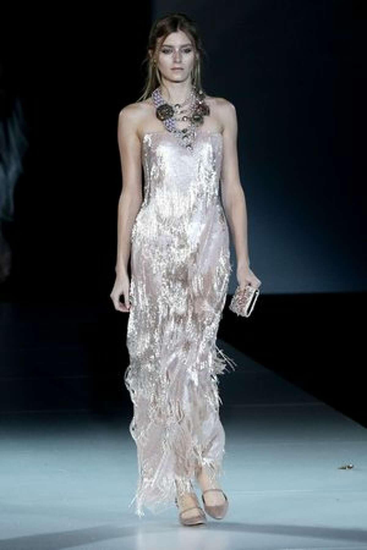 A model walks the runway during Giorgio Armani show as part of Milan Fashion Week Womenswear Autumn/Winter 2011 in Milan, Italy.