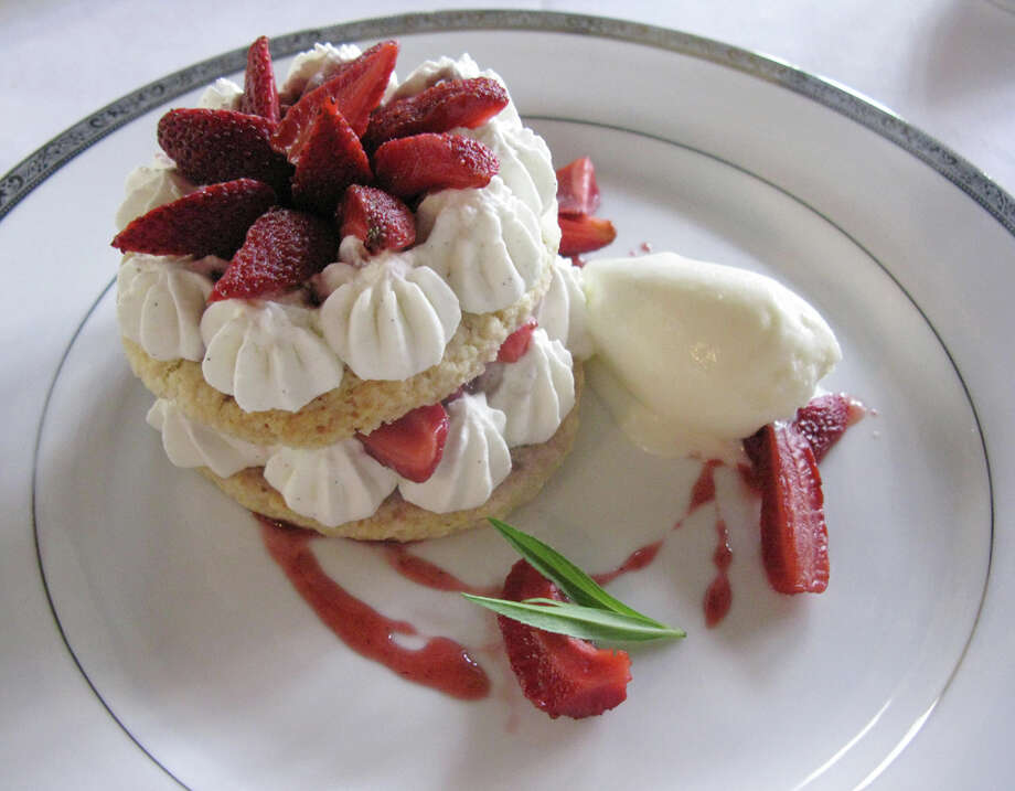Strawberry shortcake is served with fresh strawberries, whipped cream and house-made creme fraiche ice cream. JENNIFER McINNIS / EXPRESS-NEWS