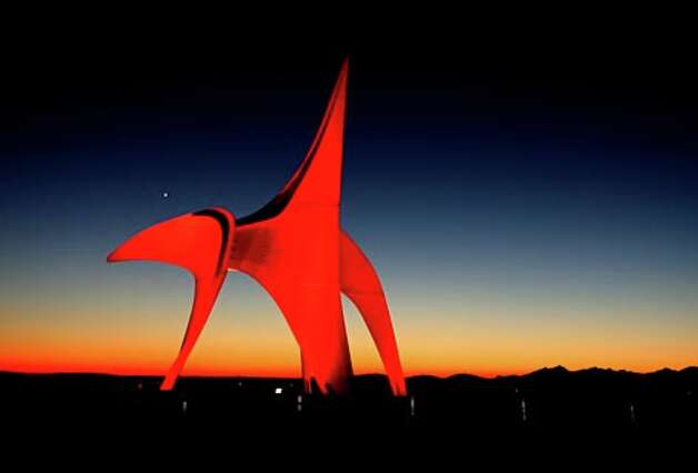 "Just after sunset, the planet Venus is visible just above Alexander Calder's 1971 sculpture ""Eagle"" at the Seattle Art Museum's Olympic Sculpture Park in Seattle on Jan. 30, 2007. (Grant M. Haller / Seattle P-I)"