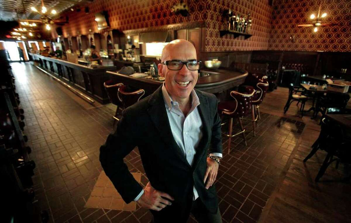 Chris Hill, owner of The Esquire Tavern, reopens the