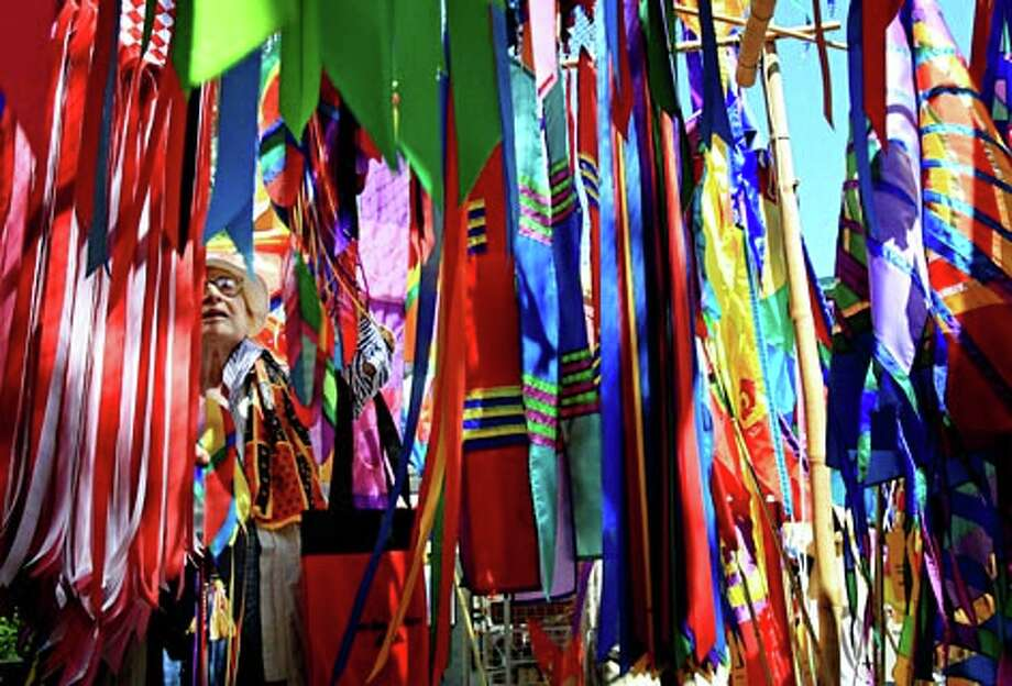 A colorful display of banners for sale at the Bellevue Arts Museum Arts Fair in 2007. (Dan DeLong / Seattle P-I)