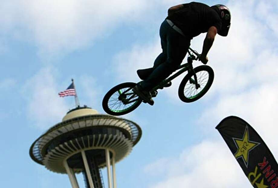 A BMX rider works the vertical ramp during a Rockstar Energy Drink performance at Bumbershoot, Seattle's annual music and arts festival, on Monday, September 1, 2008 at the Seattle Center in Seattle.