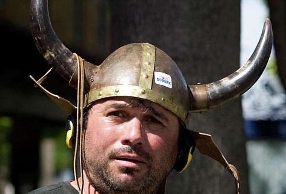 Rudy McCoy-Pantaja wears a Viking helmet while waiting for the Norwegian Constitution Day Parade on Saturday, May 17, 2008 in Ballard. (Jim Bryant / Seattle P-I)