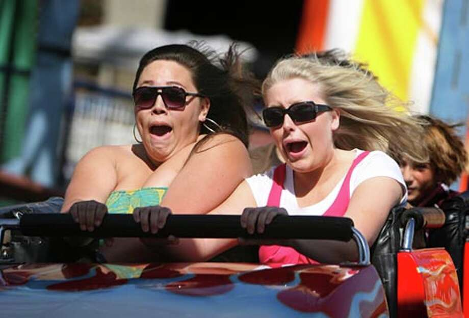 Rachelle Manglallan of Buckley and Sarah Durgin of Federal Way enjoy the ride of the Wildcat super coaster at the Puyallup Fair on September 4, 2008. (Scott Eklund / Seattle P-I) / Seattle Post-Intelligencer