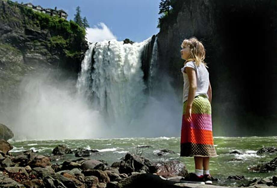 Seven-year-old Carly Nirschl takes in the view from the base of Snoqualmie Falls in Snoqualmie, Wash. on Friday, May 30, 2008. (Dan Delong / Seattle P-I)