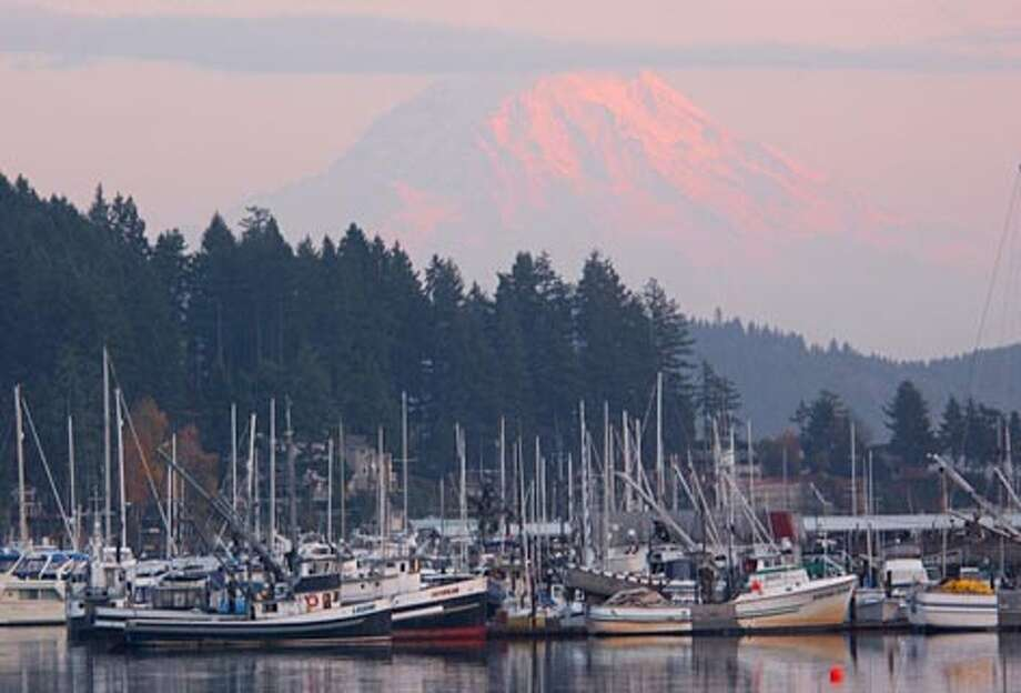 Mount Rainier hovers in solitary splendor over the picturesque scene at Gig Harbor. (Jeff Larsen / Seattle P-I)