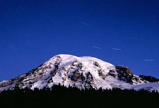 Mt. Rainier in early morning with start trails. (Andrew Nicholls / Seattle P-I file photo)