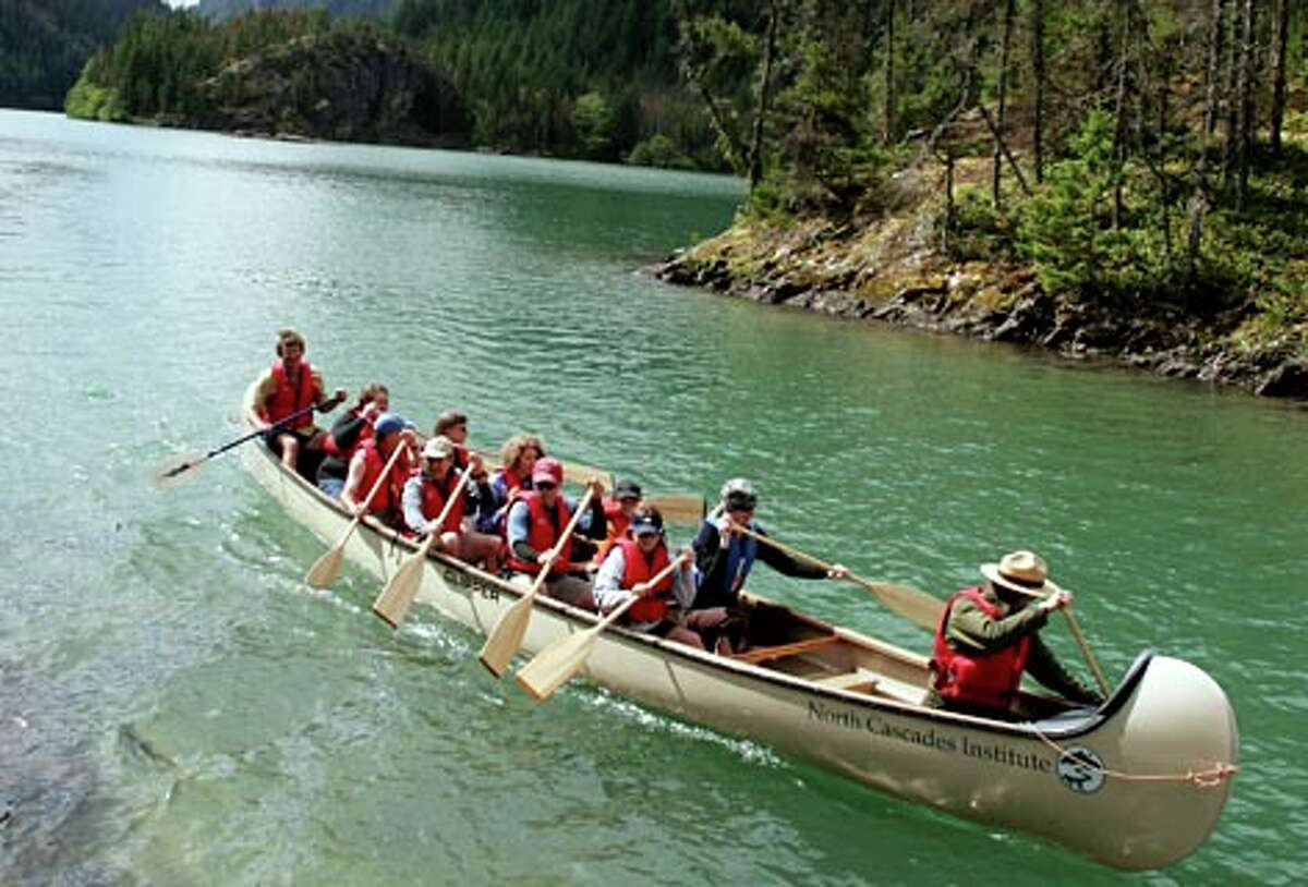 On weekends June through September, the North Cascades Institute offers two-hour guided trips in their 14-person voyager canoe on Diablo Lake in the North Cascades. (Paul Joseph Brown / Seattle P-I)