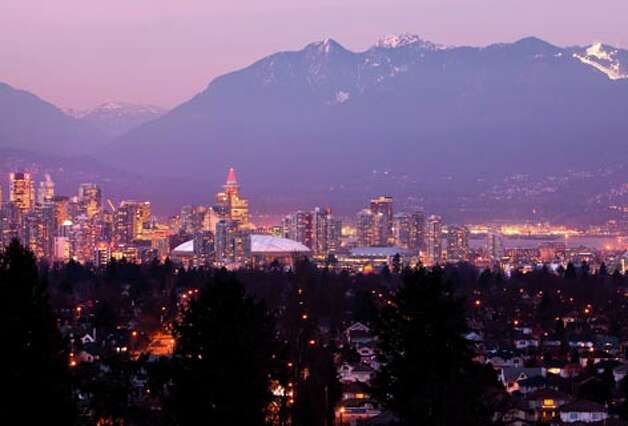The skyline of downtown Vancouver, host city for the  2010 Winter Olympics,  is seen at dusk from Queen Elizabeth Park on Tuesday, Thursday, Dec. 10, 2009. (Smiley N. Pool / Houston Chronicle)
