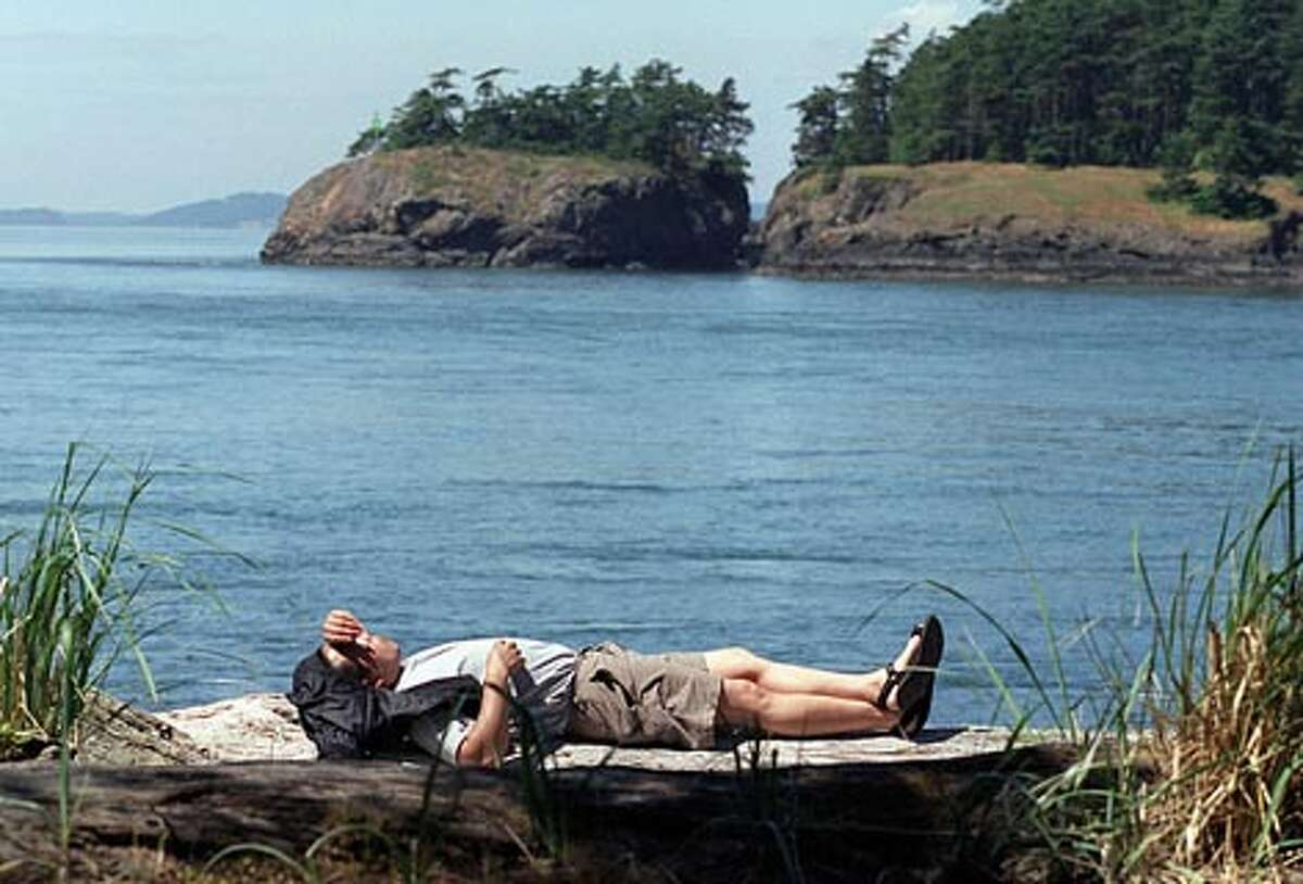 A visitor to North Beach at Deception Pass State Park enjoys a sunny day. (Gilbert W. Arias / Seattle P-I)