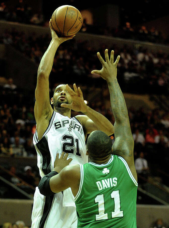 Tim Duncan of the Spurs shoots over Glen Davis of the Celtics at the AT&T Center on Thursday. BILLY CALZADA / gcalzada@express-news.net