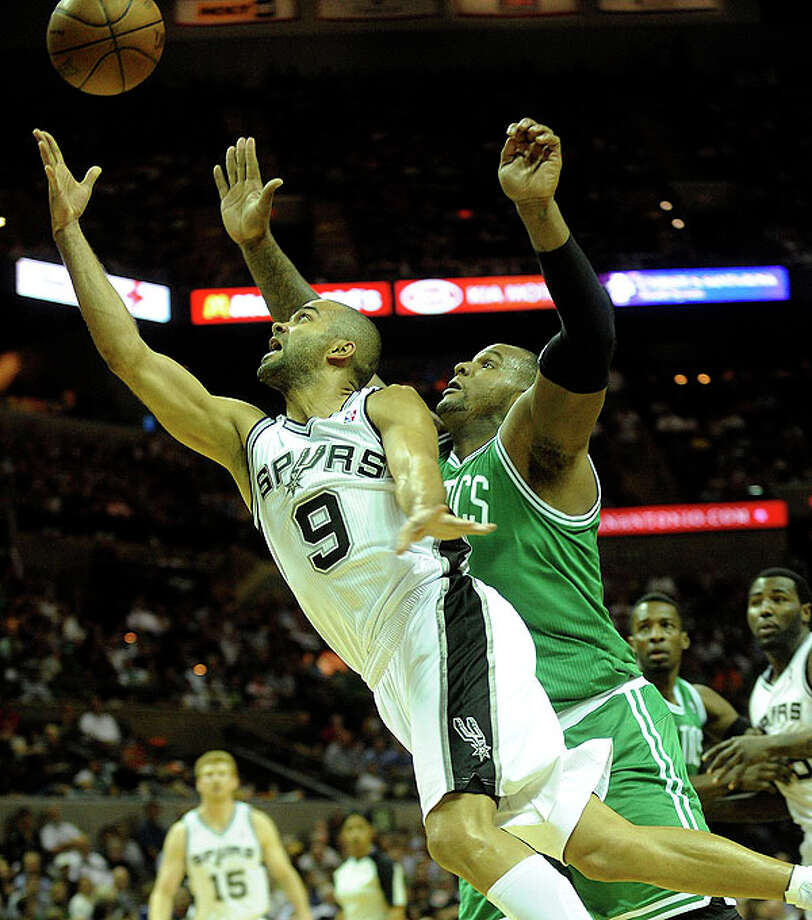 Tony Parker of the Spurs drives by Rajon Rondo of the Celtics at the AT&T Center on Thursday. BILLY CALZADA / gcalzada@express-news.net