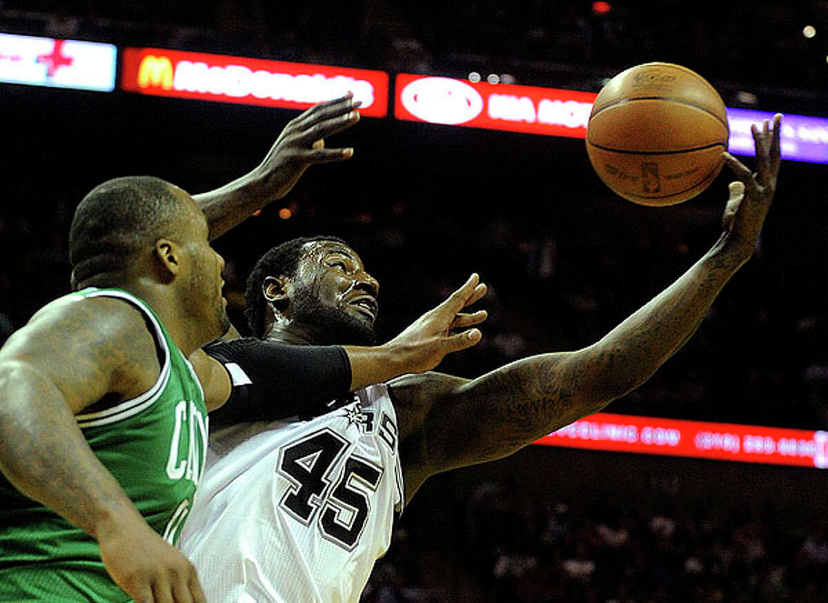 DeJuan Blair (45) of the Spurs and Glen Davis of the Celtics battle for a rebound at the AT&T Center on Thursday. BILLY CALZADA / gcalzada@express-news.net