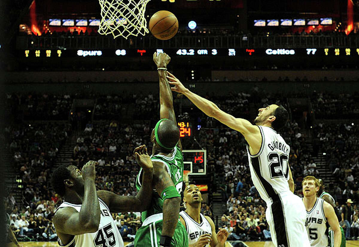 Manu Ginobili of the Spurs (right) and teammate DeJuan Blair battle Jermaine O'Neal of the Celtics for a rebound at the AT&T Center on Thursday. BILLY CALZADA / gcalzada@express-news.net