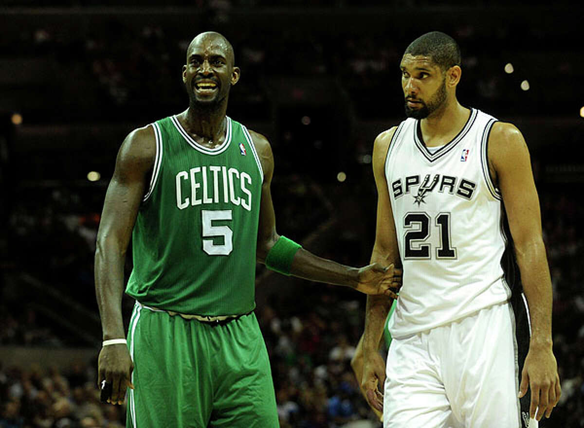 Celtics forward Kevin Garnett (left) reacts to a call as Tim Duncan of the Spurs watches at the AT&T Center on Thursday. BILLY CALZADA / gcalzada@express-news.net