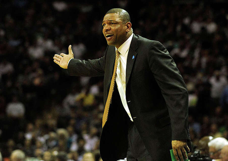 Celtics coach Doc Rivers encourages his team enroute to a 107-97 victory over the Spurs at the AT&T Center on Thursday. The Celtics won, 107-97. BILLY CALZADA / gcalzada@express-news.net