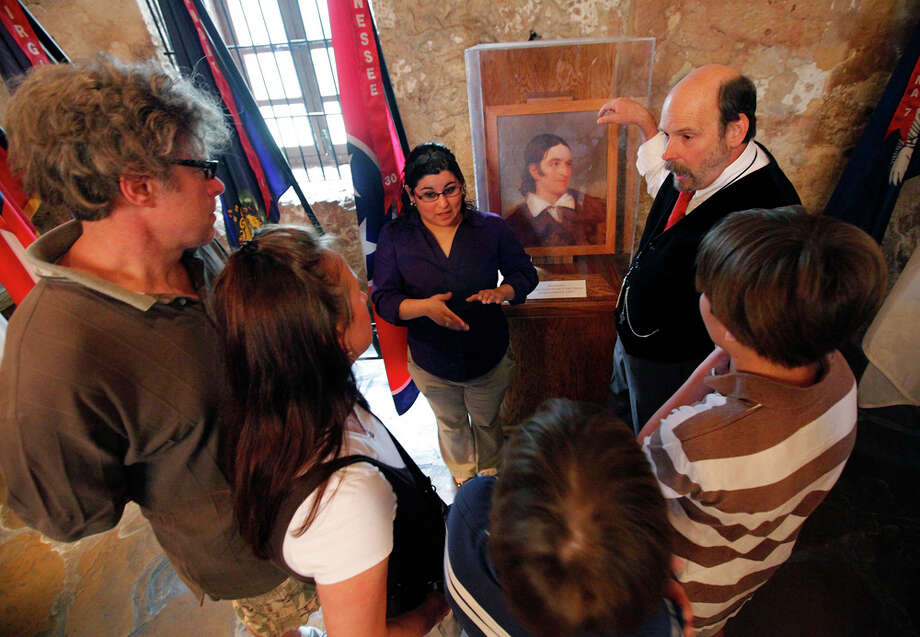 Deaf couple Bruce and Gail Fearing (right) and their two sons, Adam (pictured) and Joshua, are given a tour of the Alamo with the use of an American Sign Language interpreter Cassandra Ramirez (left) and Alamo curator Bruce Winders. Photo: Kin Man Hui / San Antonio Express-News