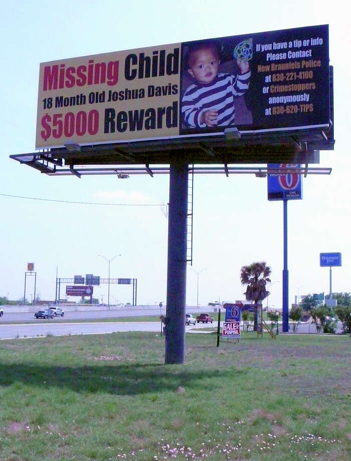 This billboard near Interstate 35 and Texas 46 in New Braunfels reminds passing drivers that Joshua Davis Jr., the toddler who went missing in February, still hasn't been found / © 2011 San Antonio Express-News