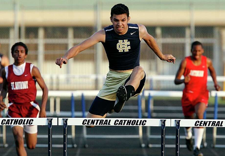Holy Cross' James Stark wins the 300-meter hurdles at the TAPPS District 2-5A meet. EDWARD A. ORNELAS/eaornelas@express-news.net