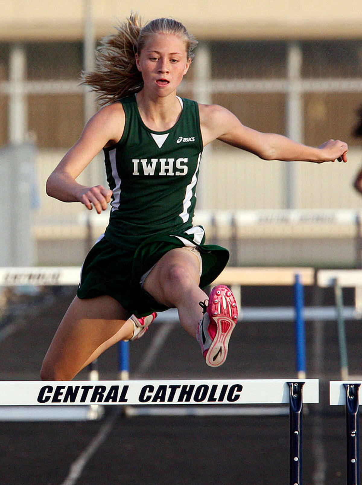 Incarnate Word's Emily Phillips clears the last hurdle in the 300-meter hurdles during the TAPPS 2-5A District Track Meet Thursday March 31, 2011 at Central Catholic High School. Phillips finished in first place.  EDWARD A. ORNELAS/eaornelas@express-news.net)