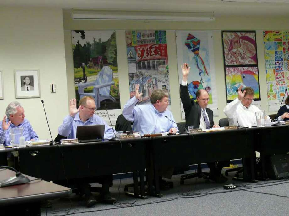 Fairfield Board of Finance members, from left, Michael Tetreau, Kevin Kiley, Chairman Thomas Flynn, Vice Chairman Robert Bellitto Jr, and Chris DeWitt vote on the $264 million town budget at Thursday night's meeting. Photo: Genevieve Reilly / Fairfield Citizen contributed