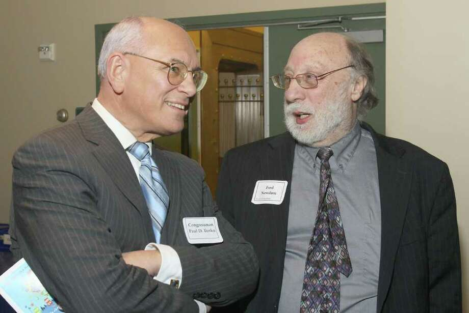 Congressman Paul Tonko, left, talks with Fred Newdom, president of the Music Mobile?s board of directors, in Albany, N.Y., at Music Mobile's 33rd Anniversary Celebration March 24, 2011. (Photo by Joe Putrock / Special to the Times Union) Photo: Joe Putrock / Joe Putrock