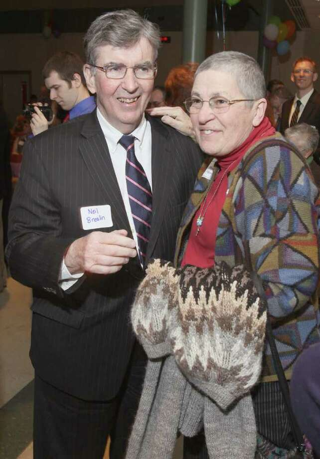 Sen. Neil Breslin greets Margie Skinner, whom he has known for more than 40 years.  Albany, N.Y., at Music Mobile's 33rd Anniversary Celebration March 24, 2011. (Photo by Joe Putrock / Special to the Times Union) Photo: Joe Putrock / Joe Putrock