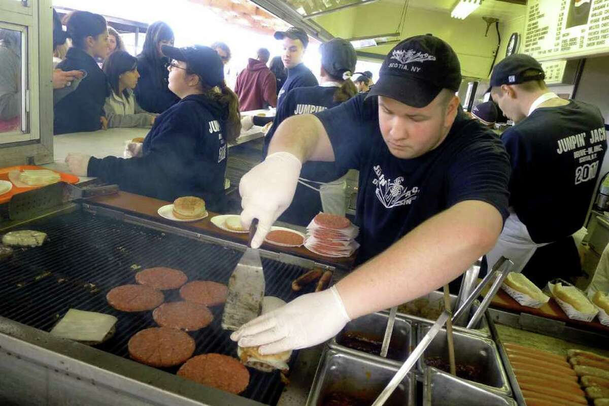 John Lenkowich tends the grill during the opening day of Jumpin' Jacks in Scotia Thursday March 31,2011.( Michael P. Farrell/Times Union )