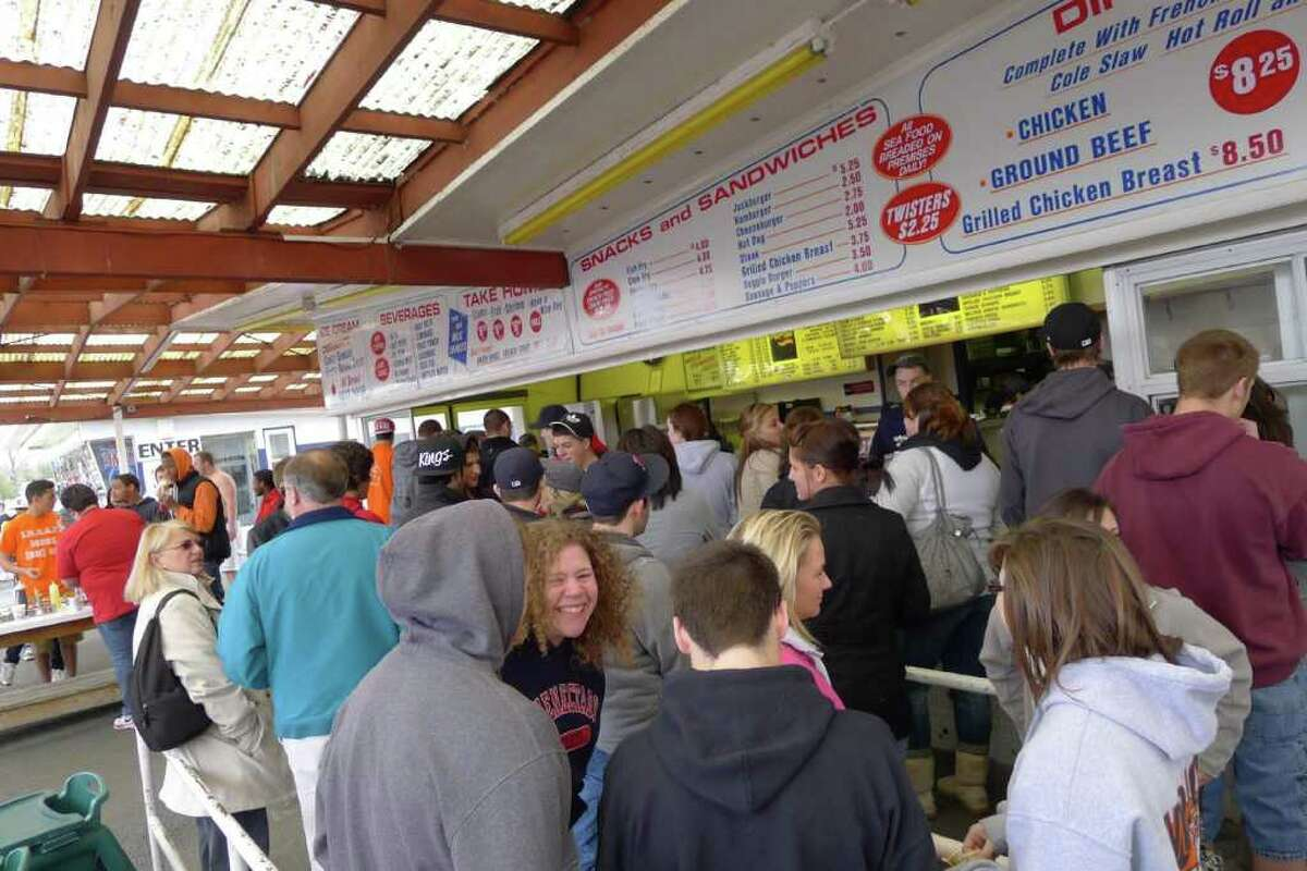 Patrons wait their turn in line during the opening day of Jumpin' Jacks in Scotia Thursday March 31,2011.( Michael P. Farrell/Times Union )