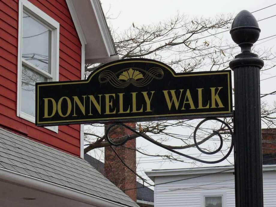 Residents react to the lifes sentence given to Christopher DiMeo who murdered local jewelry shop owners Kim and Tim Donnelly in 2005. A pedestrian walkway between Sanford Street and Uquowa Road is named in their memory. Photo: Genevieve Reilly / Fairfield Citizen
