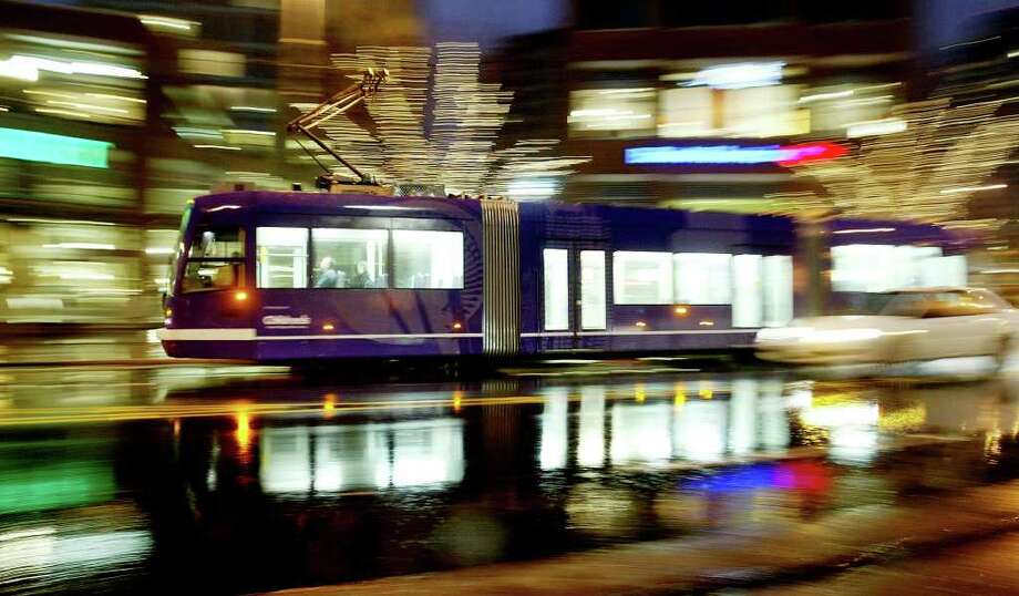 A northbound South Lake Union Streetcar travels north along Westlake Ave. North, near Denny Way, in Seattle on a rainy evening, Monday, January 14, 2008. (Seattle Post-Intelligencer/Dan DeLong)