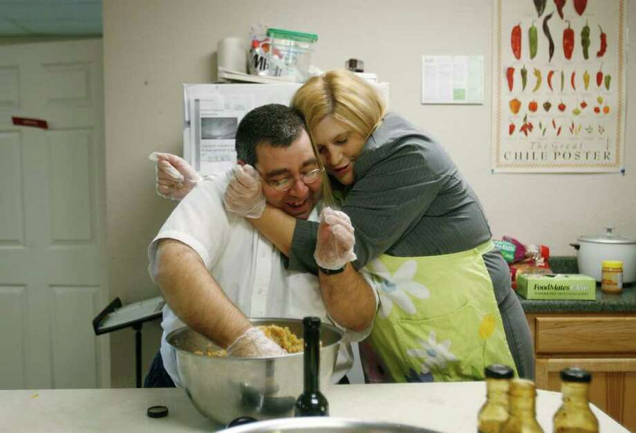 Stephanie Lane, program director for the Office of Consumer Partnerships in the state's Mental Health Division, hugs Capital Clubhouse member Joey Scardina while they prepared lunch at the Olympia, Wash. facility on Monday, October 27, 2008. The Capital Clubhouse is a program for people with mental illness. (Seattle Post-Intelligencer/Dan DeLong)