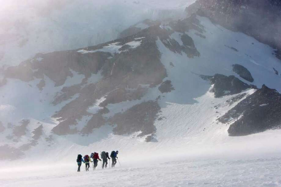 Members of the Fred Hutchinson Cancer Research Center's Big Expedition for Cancer Research team climb up to Camp Muir on Mount Rainier May 20, 2008. Including four researchers from Fred Hutch, this was a practice climb for a virgin ascent of an unnamed, 8300-foot peak in Glacier Bay National Park in Alaska.