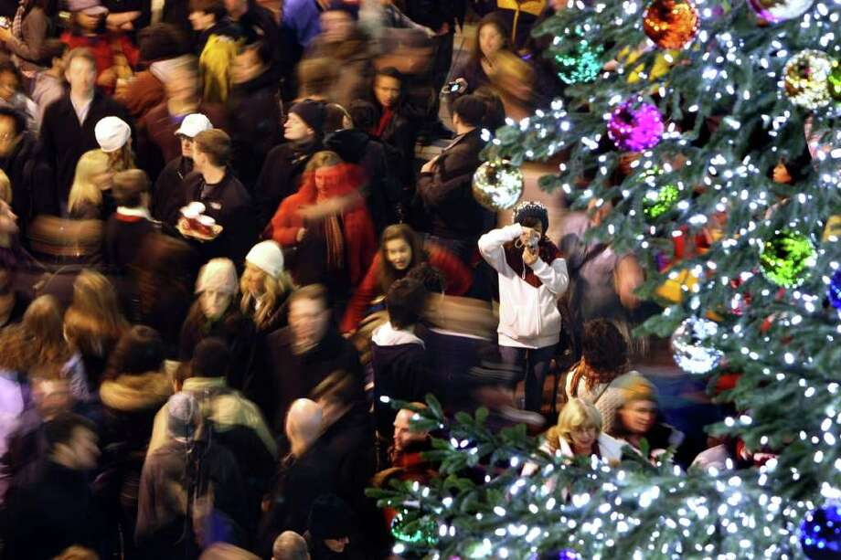 Crowds packed Westlake Center as the tree was lit for the first time in downtown Seattle on November 28, 2008.  (Seattle Post-Intelligencer/Karen Ducey)
