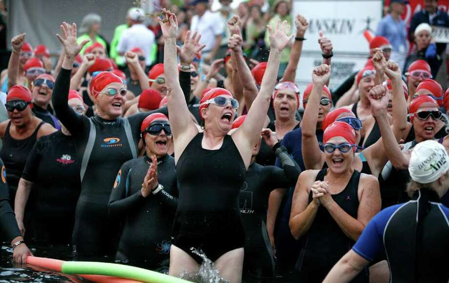 Brown: OK, I'm a pretty serious swimmer, but you'd have to hold a gun to my head to get me into Lake Washington on a cold, stormy morning.  Thousands of women saw it differently at the 2008 Danskin Triathalon. These women were getting charged up before their half-mile swim. Aug. 17 Photo: Paul Joseph Brown