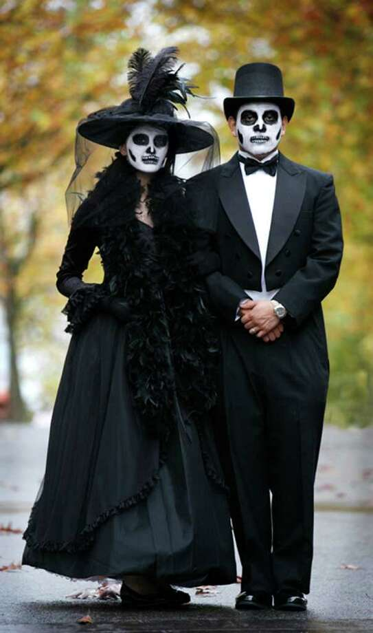 Brown:Zulley Diaz and Joel Mercado are properly attired for Dia de Muertos (Day of the Dead) celebrations at Seattle Center. These real-life young sweethearts had a natural elegance about them, strolling about hand in hand dressed and made up as dead lovers from early in the previous century. Nov. 1 Photo: Paul Joseph Brown