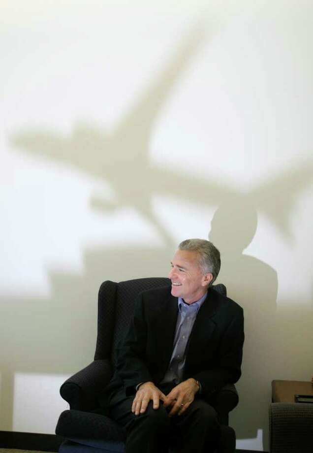 Doug Kight, Boeing's new labor relations chief, is photographed at his Renton, office on Thursday April 17, 2008Kight:I used a small airplane model on a table and put a flash in front of it to cast the shadow on the wall. Also got some nice light on his face as well. Photo: Scott Eklund, Seattle Post-Intelligencer / Seattle Post-Intelligencer