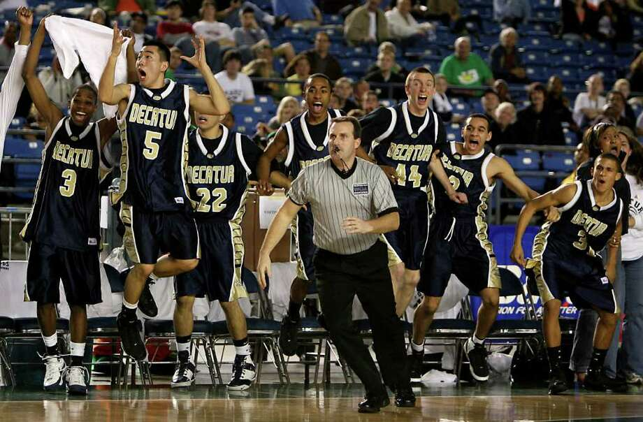 The Decatur bench erupts after holding on for the 57-55 win with 1.3 seconds left. Shadle Park wasn't able to score as Decatur High School won in the quarterfinals of the WIAA Boys' 4A state championship at the Tacoma Dome. on Thursday February 28, 2008.