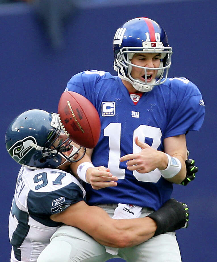 One of the few bright spots for the Seahawks' defense was this second-quarter sack of Eli Manning by Patrick Kerney but it wasn't nearly enough as the New York Giants beat the Seattle Seahawks 44-6 at Giants' Stadium in East Rutherford, N.J. on Sunday October 5, 2008.