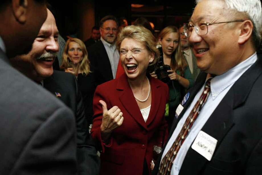 Governor Christine Gregoire laughs with supporters at a private function at the Democratic Election Night Party held at the Westin Hotel  in Seattle, Wash., Tuesday November 4, 2008.